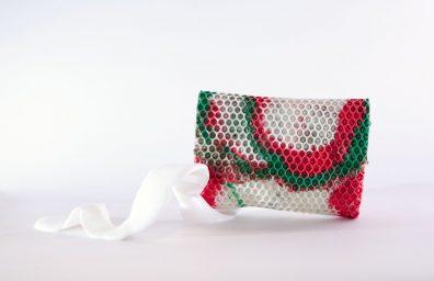 Wrap bag clutch in poliuretano mimetico rosa design Matteo Pellegrino